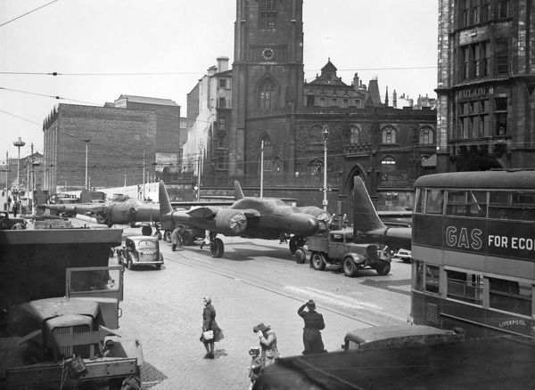 P-61 Black Widow aircraft passing the church in St George's Dock gates, Liverpool