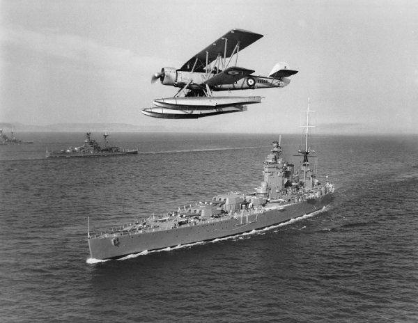 Blackburn Shark II seaplane flying over HMS Nelson, Weymouth, 1938