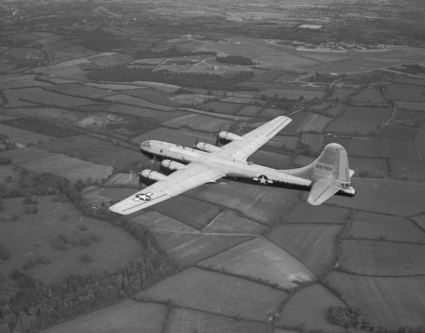 Boeing B-29 Superfortress (45-21752) in flight over the English countryside, 1945