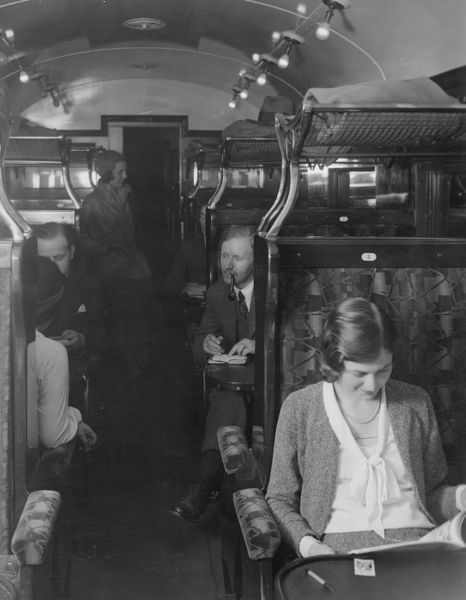 Passengers in a carriage of a Southern Railway 6-Pul electric train