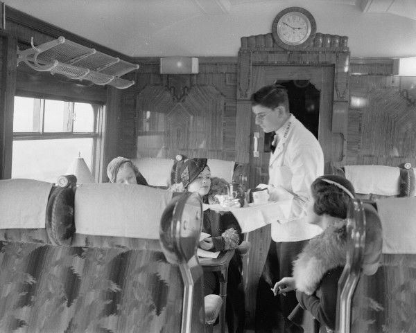 A waiter serving tea in a Pullman carriage