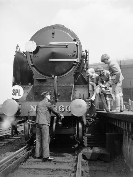 Three children talking to the driver of Southern Railway 860 4-6-0 Lord Hawke, Waterloo Station 1934