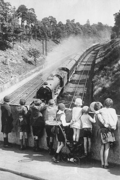 Children watching the Atlantic Coast Express. This is a composite photograph