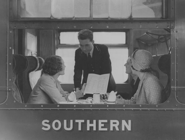 The Steward checks the lady's order in a Southern Railway dining car