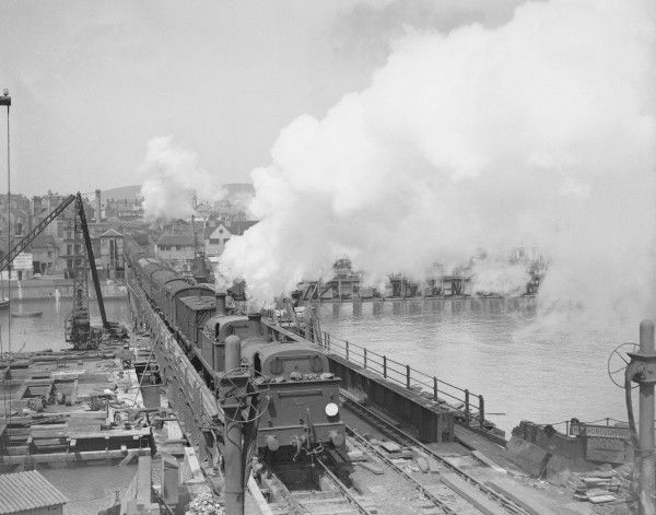 Southern Railway tank engines assist a boat train over the Folkestone Harbour swing bridge