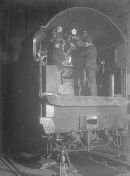 A King Arthur Class 4-6-0 locomotive being repaired in a Southern Railway locomotive works