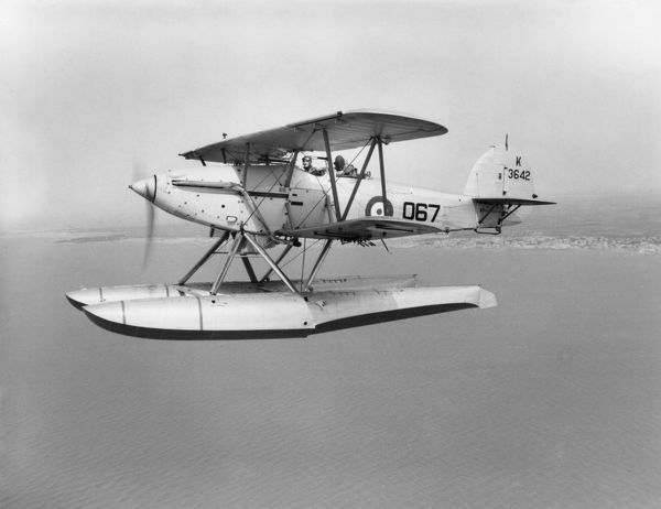 Hawker Osprey III (K3642 067) of 447 Flight in flight over Alexandria harbour, 1936