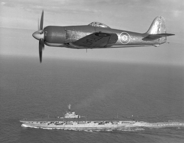 Hawker Sea Fury FB.10 (TF947) of 803 Squadron RCN flying over HMCS Magnificent, 6 May 1948