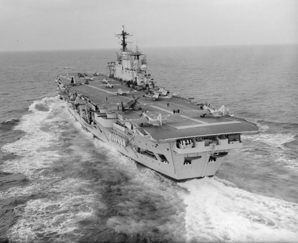 HMS Eagle with aircraft on deck