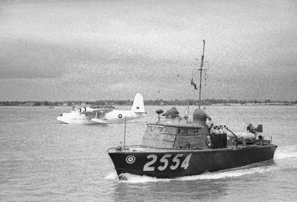 "68' High Speed Launch type 3 ""Hants and Dorset"", with Short Sunderland aircraft in the background, 1944"