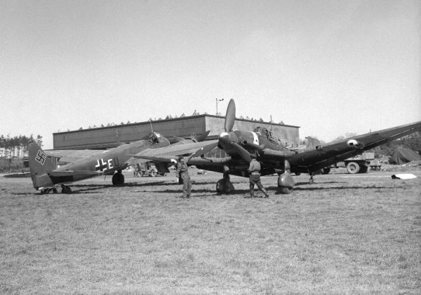 Junkers Ju 87D & Junkers Ju 88 on the aerodrome at Langenhagen, Germany, after capture in 1945