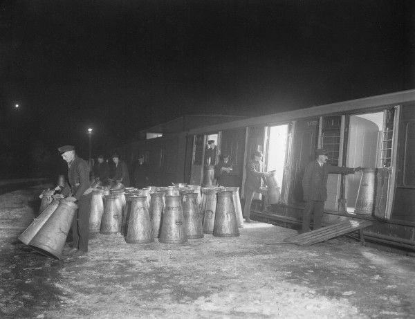 Unloading milk churns from Southern Railway wagons at Clapham Junction station