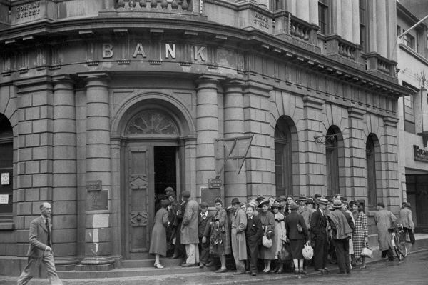 Local civilians queuing outside Lloyds Bank, St Helier, Jersey, May 1945