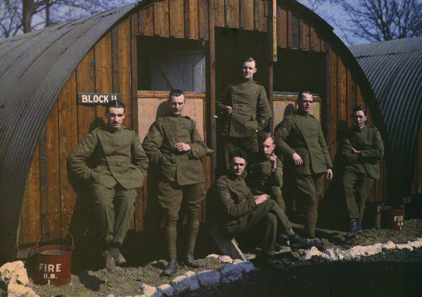 Non-Commissioned Officers in Royal Flying Corps uniform relaxing outside their hut, 1918; a rare colour photograph