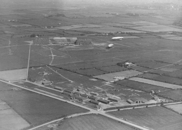 The airship station and aerodrome on Anglesey, with Sea Scout Zero airships in the distance