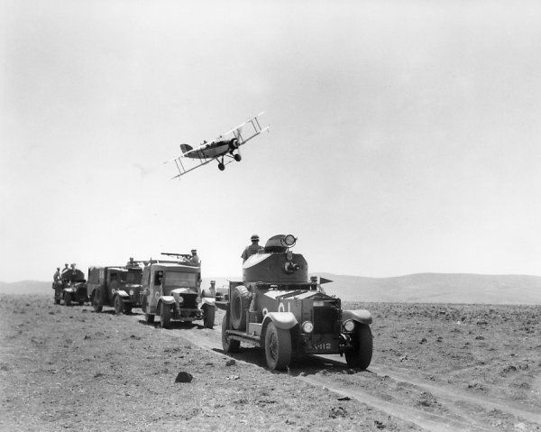 Fairey Gordon (K2636) of 6 Squadron flying over a convoy of Royal Air Force armoured cars near the Jordan Valley, 1936