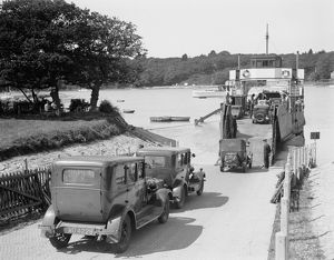 Cars and motorcycles arriving on board the ferry at Fishbourne,